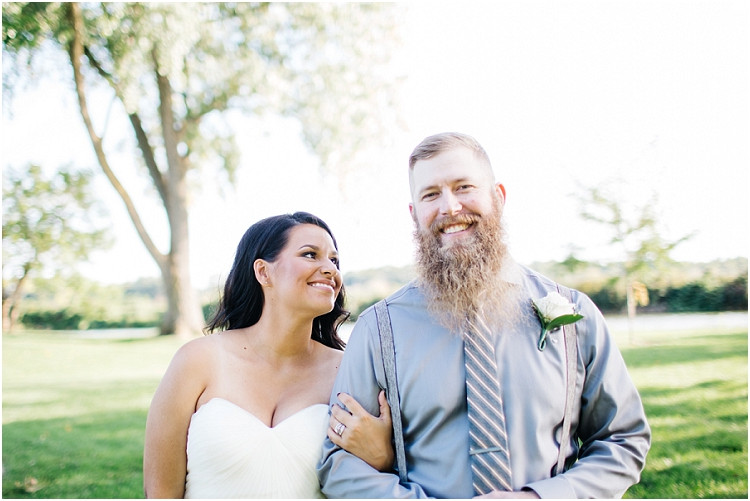 groom-smiling-at-camera-at-little-chute-waterfront-wedding-by-appleton-wedding-photographer-kyra-rane-photography