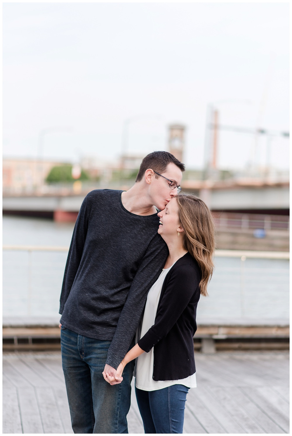 kissing-forehead-at-downtown-green-bay-engagement-session-by-appleton-wedding-photographer-kyra-rane-photography