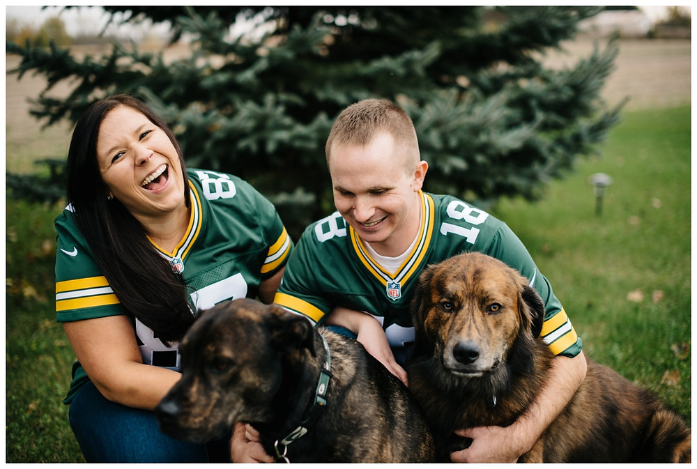 engaged-couple-with-dogs-at-green-bay-engagement-session-by-green-bay-wedding-photographer-kyra-rane-photography