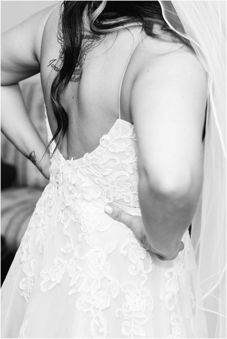 back-of-bride-in-white-lace-wedding-dress-at-de-pere-wisconsin-wedding-by-green-bay-wedding-photographer-kyra-rane-photography