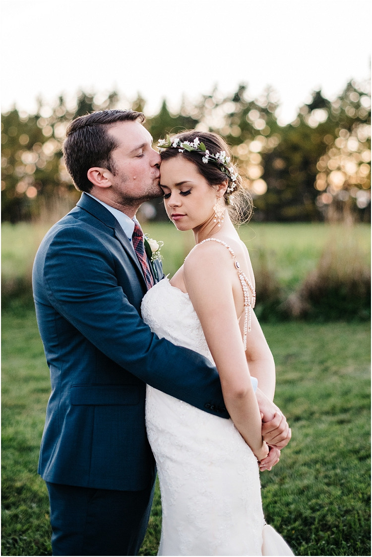 wedding-couple-wrapped-up-at-sunset-at-barnsite-retreat-and-events-wedding-by-appleton-wedding-photographer-kyra-rane-photography