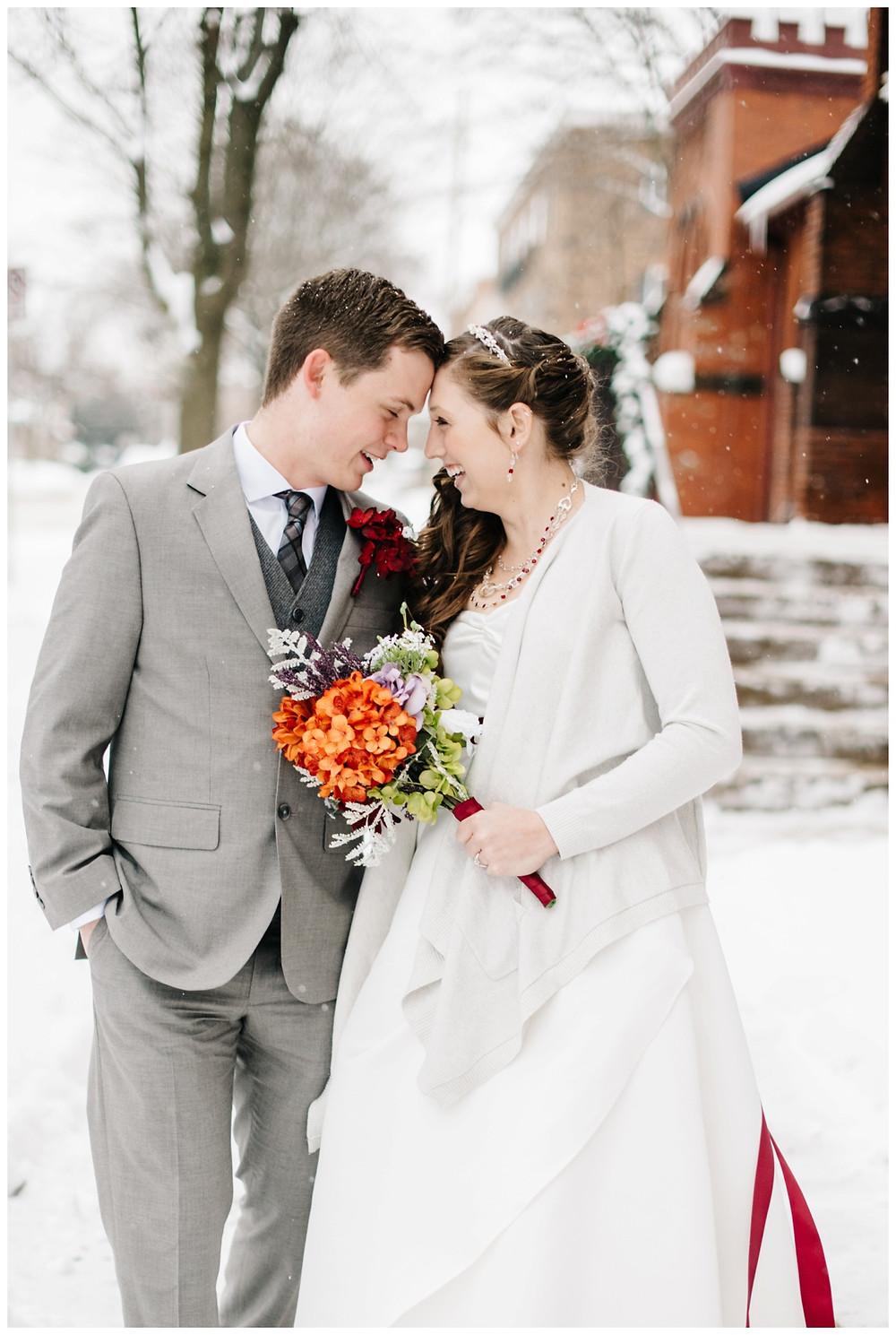 bride-and-groom-laughing-in-snow-at-milwaukee-wedding-by-milwaukee-wedding-photographer-kyra-rane-photographer