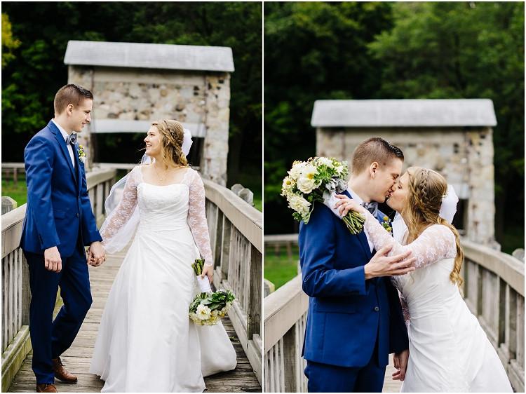 bride-and-groom-kiss-on-bridge-at-pamperin-park-wedding-by-appleton-wedding-photographer-kyra-rane-photography