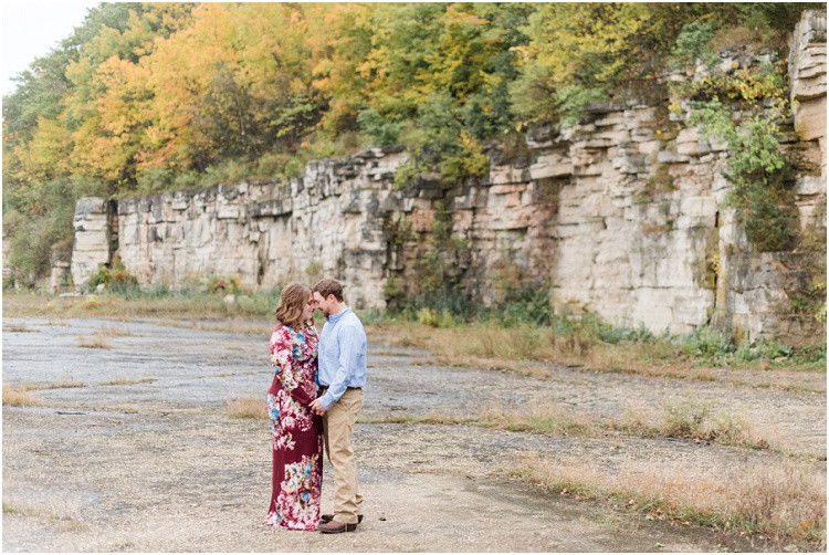 engaged-couple-hold-stand-close-by-bluffs-at-high-cliff-engagement-session-by-green-bay-wedding-photographer-kyra-rane-photography
