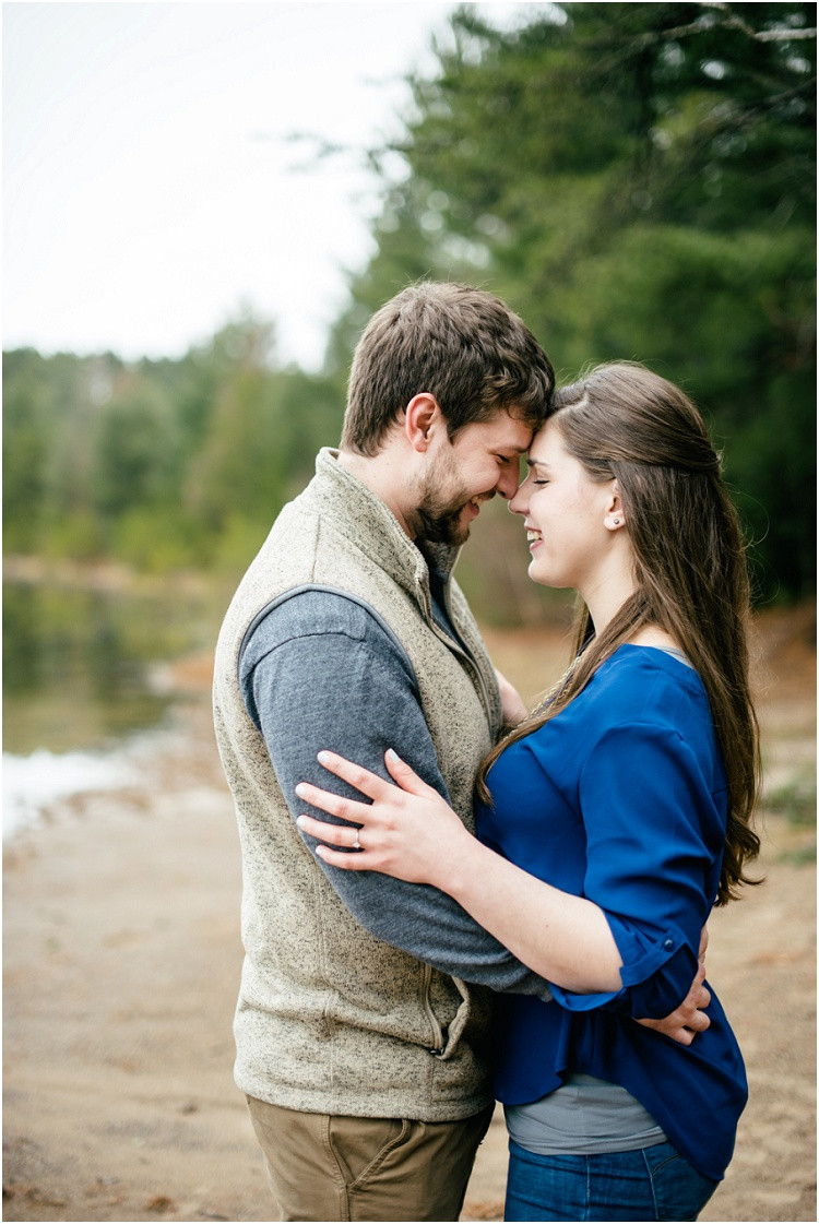 engaged-couple-holding-each-other-at-northwoods-lakeside-engagement-session-by-milwaukee-wedding-photographer-kyra-rane-photography