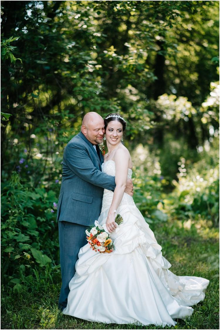 wedding-couple-hugging-at-wisconsin-farm-wedding-by-appleton-wedding-photographer-kyra-rane-photography