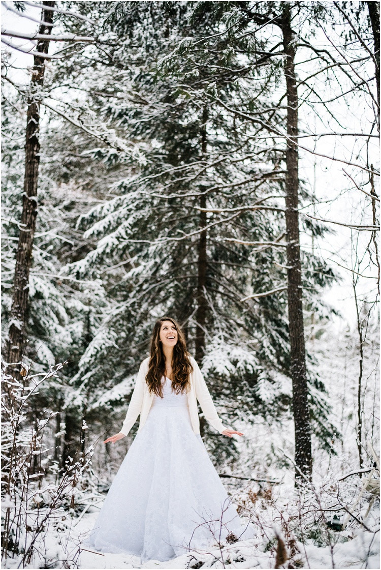 winter-bride-looking-up-at-trees-at-wisconsin-winter-bridal-portraits-by-milwaukee-wedding-photographer-kyra-rane-photography