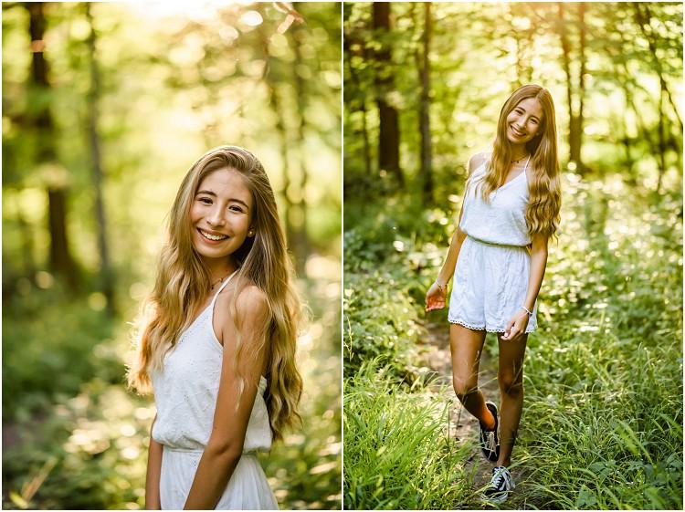 senior-smiling-towards-camera-walking-in-forest-at-senior-session-at-plamann-park-by-green-bay-wedding-photographer-kyra-rane-photography