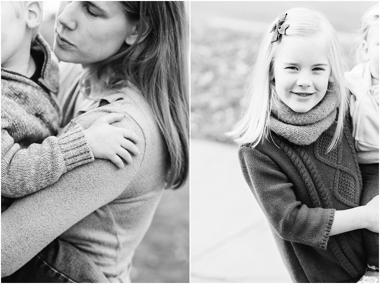 sisters-smiling-at-camera-at-front-porch-family-session-by-green-bay-wedding-photographer-kyra-rane-photography