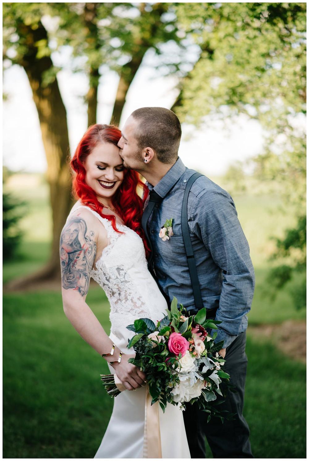 groom-kissing-brides-forehead-at-homestead-meadows-styled-shoot-by-appleton-wedding-photographer-kyra-rane-photography