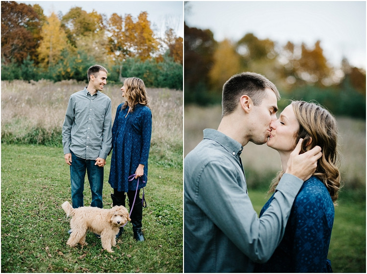 couple-kissing-with-puppy-at-fall-mini-session-favorites-by-appleton-wedding-photographer-kyra-rane-photography