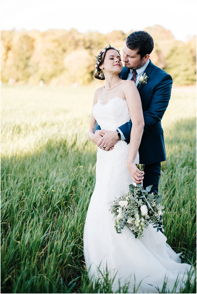 wedding-couple-in-field-looking-at-each-other-at-barnsite-retreat-and-events-wedding-by-milwaukee-wedding-photographer-kyra-rane-photography