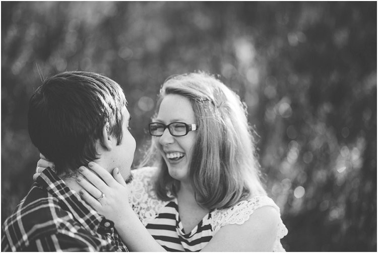 couple-sitting-and-laughing-at-maywood-environmental-park-engagement-session-by-appleton-wedding-photography-kyra-rane-photography
