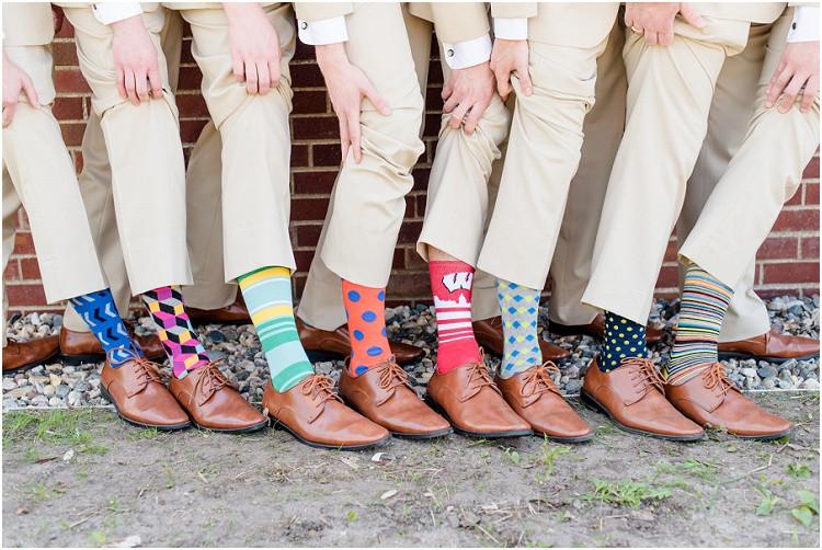 groom-and-groomsmen-showing-fun-socks-at-minnesota-wedding-by-milwaukee-wedding-photographer-kyra-rane-photography