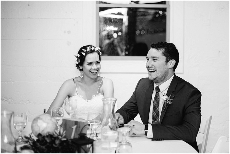 bride-and-groom-laughing-at-dinner-table-at-barnsite-retreat-and-events-wedding-by-appleton-wedding-photographer-kyra-rane-photography