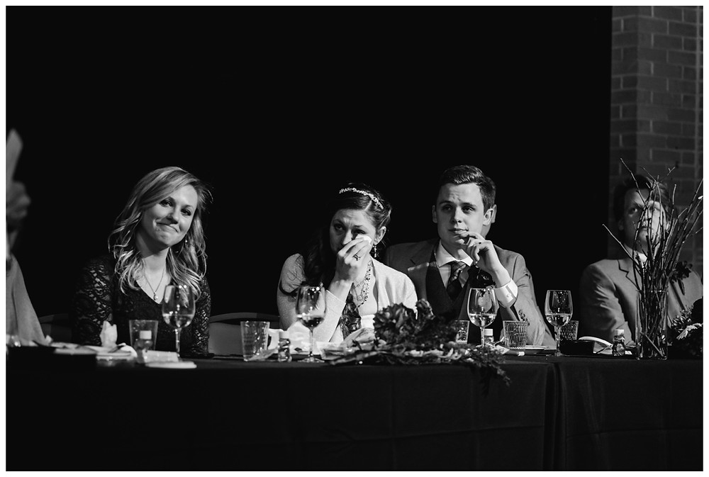 wedding-couple-listening-to-toasts-at-milwaukee-wedding-by-milwaukee-wedding-photographer-kyra-rane-photographer