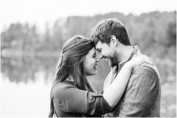 engaged-couple-laughing-with-foreheads-together-at-northwoods-lakeside-engagement-session-by-milwaukee-wedding-photographer-kyra-rane-photography