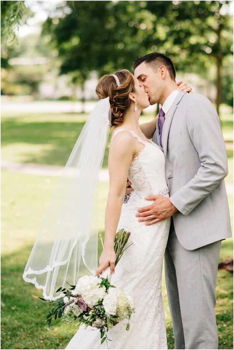 wedding-couple-hold-each-other-and-kiss-at-best-western-premier-waterfront-hotel-wedding-by-green-bay-wedding-photographer-kyra-rane-photography