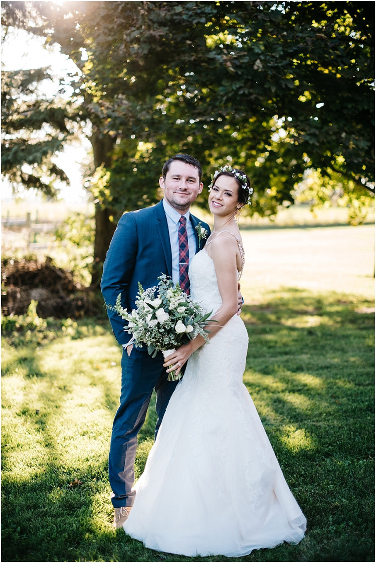 wedding-couple-smiling-at-camera-at-barnsite-retreat-and-events-wedding-by-appleton-wedding-photographer-kyra-rane-photography