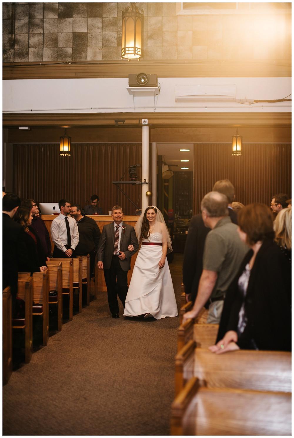 bride-walking-down-aisle-at-milwaukee-wedding-by-milwaukee-wedding-photographer-kyra-rane-photographer