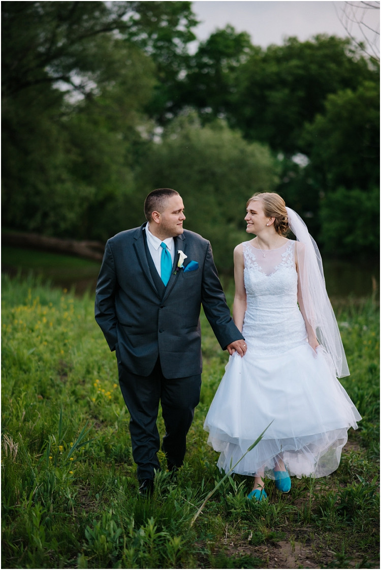 wedding-couple-holding-hands-and-walking-at-olde-41-wedding-by-appleton-wedding-photographer-kyra-rane-photography