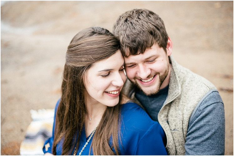 engaged-couple-smilting-with-temples-together-at-northwoods-lakeside-engagement-session-by-milwaukee-wedding-photographer-kyra-rane-photography