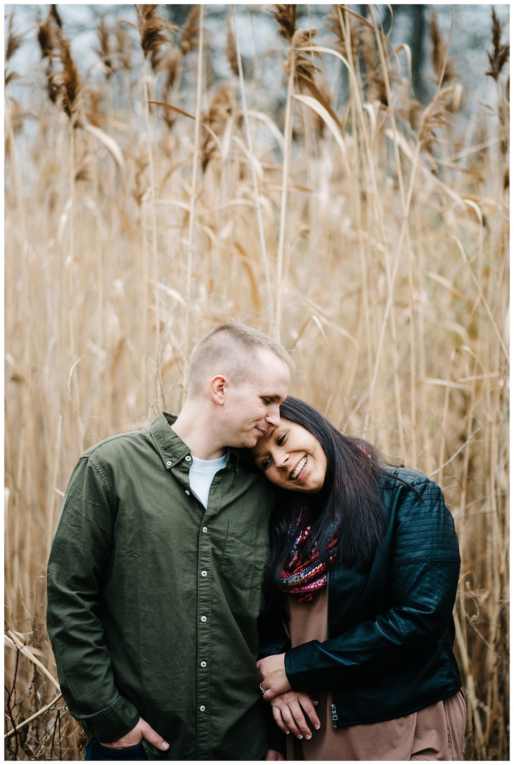 engaged-couple-cozy-together-in-wheat-field-at-green-bay-engagement-session-by-appleton-wedding-photographer-kyra-rane-photography