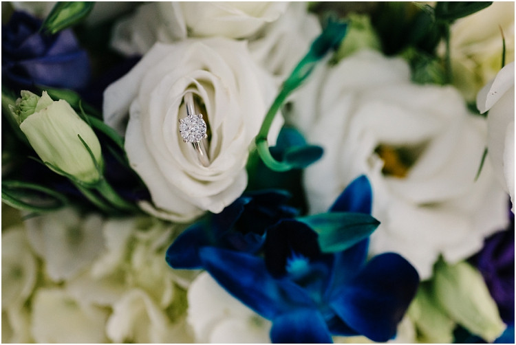 wedding-ring-in-flower-at-olde-41-wedding-by-green-bay-wedding-photographer-kyra-rane-photography