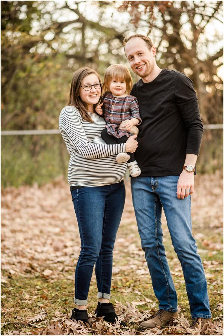 family-smiling-at-camera-at-backyard-family-session-by-appleton-wedding-photographer-kyra-rane-photography