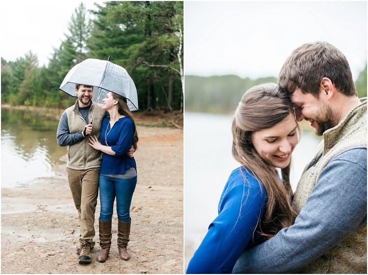 engaged-couple-walking-under-umbrella-by-lake-at-northwoods-lakeside-engagement-session-by-appleton-wedding-photographer-kyra-rane-photography