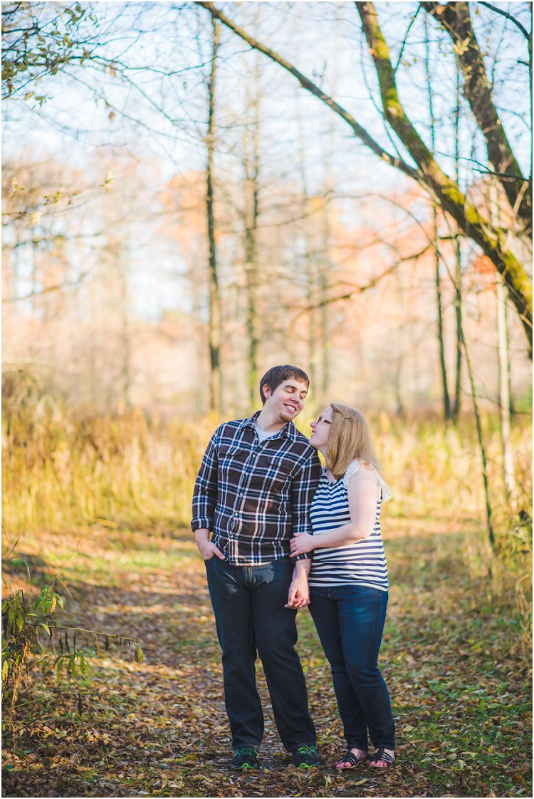 couple-holding-hands-and-smiling-at-maywood-environmental-park-engagement-session-by-green-bay-wedding-photography-kyra-rane-photography