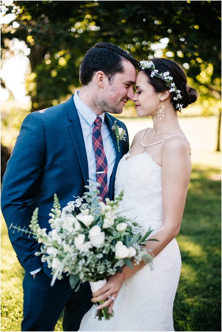 wedding-couple-foreheads-together-smiling-at-barnsite-retreat-and-events-wedding-by-milwaukee-wedding-photographer-kyra-rane-photography