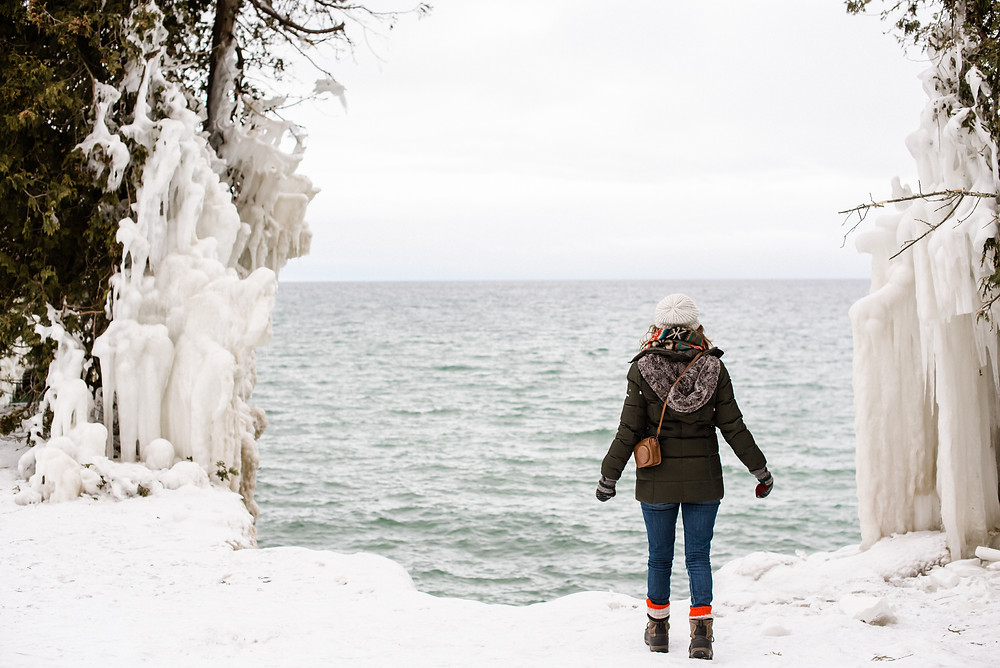 looking-at-frozen-lake-michigan-at-dear-extrovert-by-green-bay-wedding-photographer-kyra-rane-photography