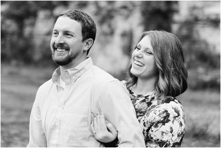 engaged-couple-laughing-away-from-camera-at-high-cliff-engagement-session-by-green-bay-wedding-photographer-kyra-rane-photography