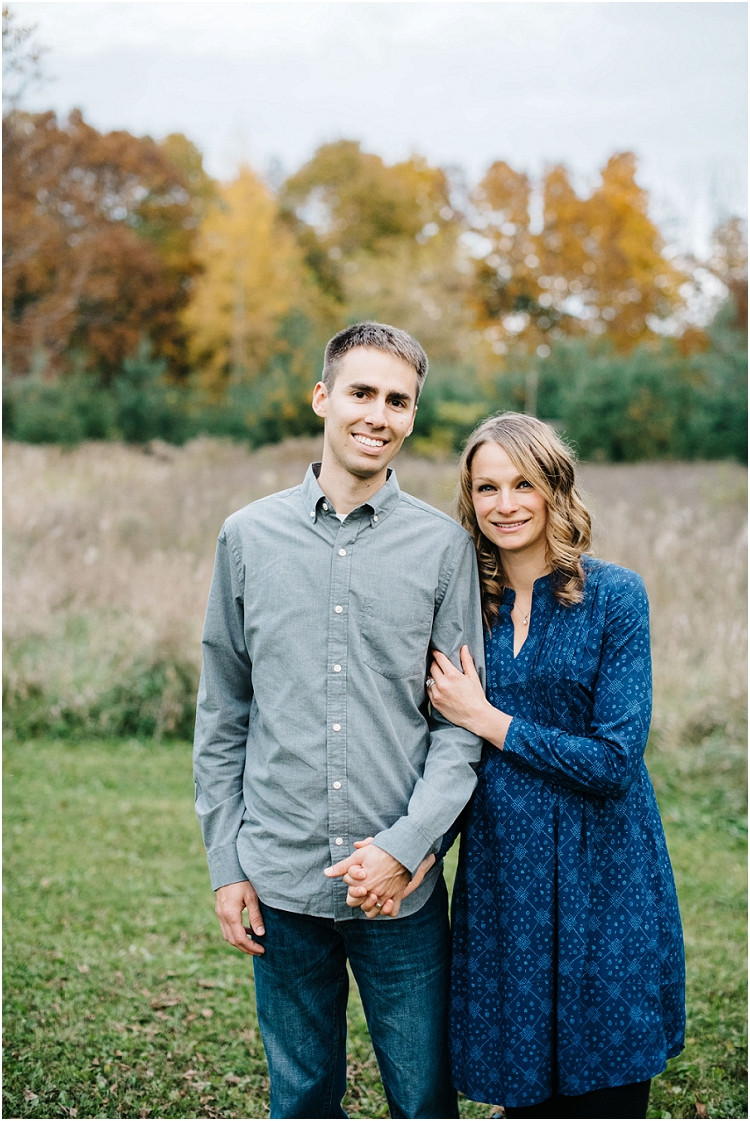 couple-looking-at-camera-arms-linked-at-fall-mini-session-favorites-by-green-bay-wedding-photographer-kyra-rane-photography