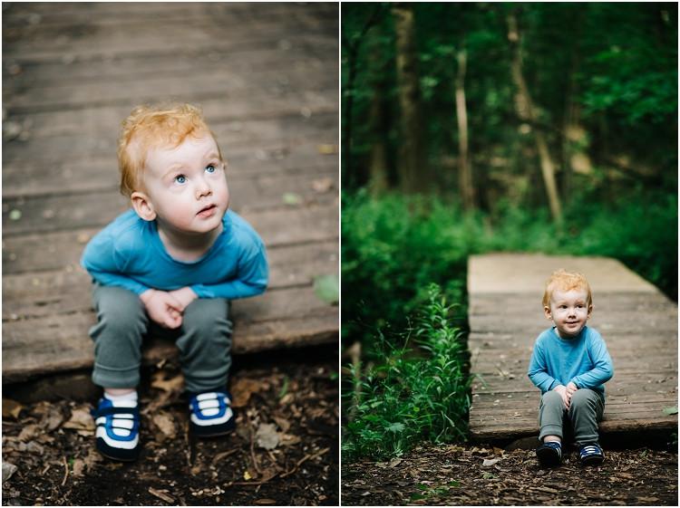son-sitting-at-edge-of-bridge-at-plamann-park-session-by-green-bay-wedding-photography-kyra-rane-photography