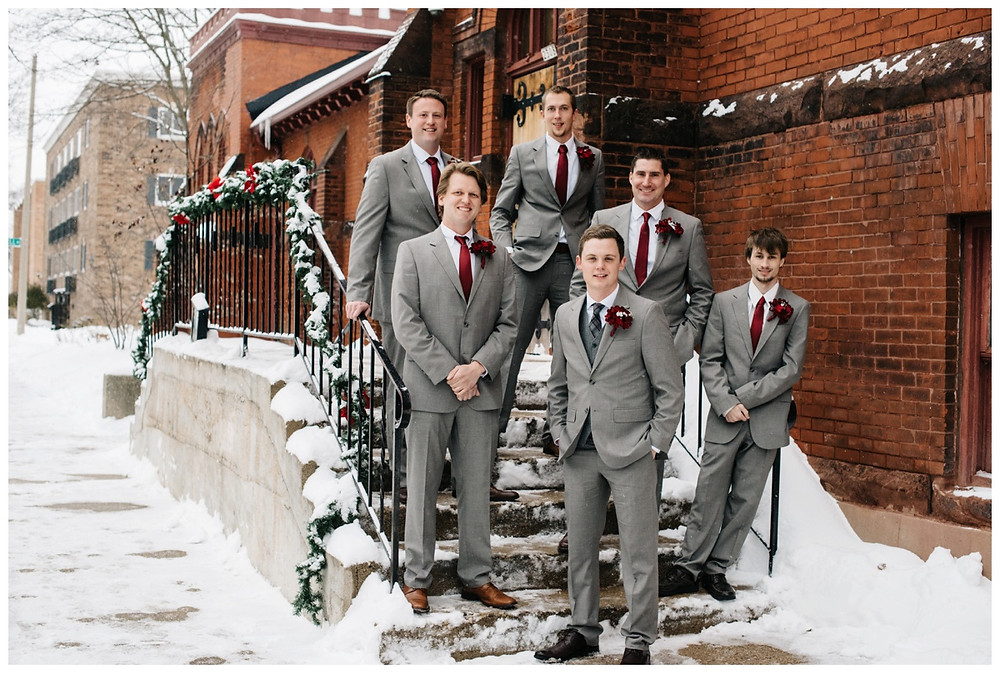 groomsmen-standing-on-steps-looking-at-camera-at-milwaukee-wedding-by-milwaukee-wedding-photographer-kyra-rane-photographer