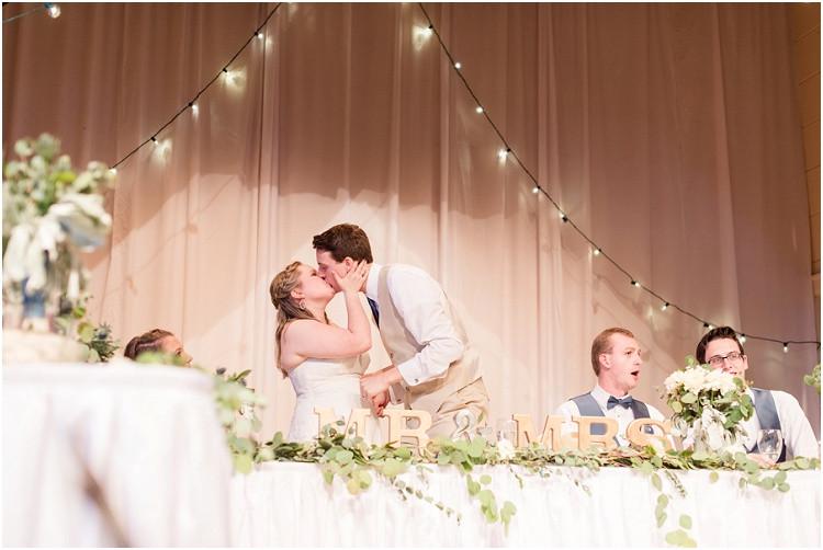bride-and-groom-share-reception-kiss-at-minnesota-wedding-by-green-bay-wedding-photographer-kyra-rane-photography