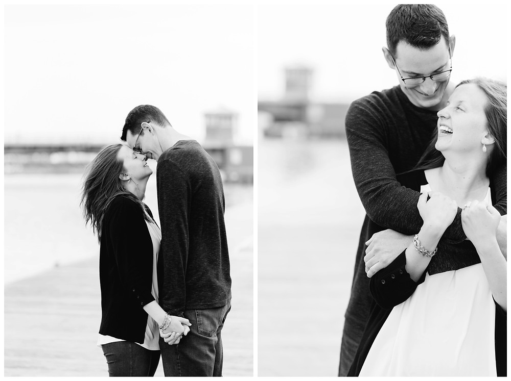 engaged-couple-laughing-at-each-other-holding-arms-at-downtown-green-bay-engagement-session-by-green-bay-wedding-photographer-kyra-rane-photography