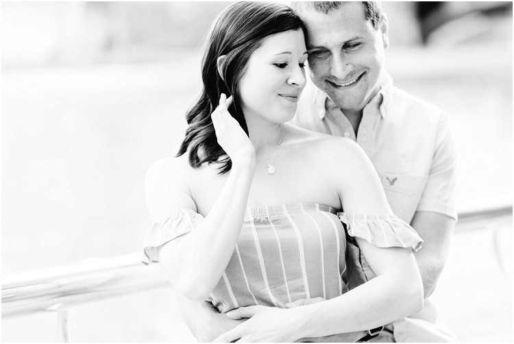 husband-holding-wife-close-by-river-at-downtown-chicago-anniversary-session-by-milwaukee-wedding-photographer-kyra-rane-photography