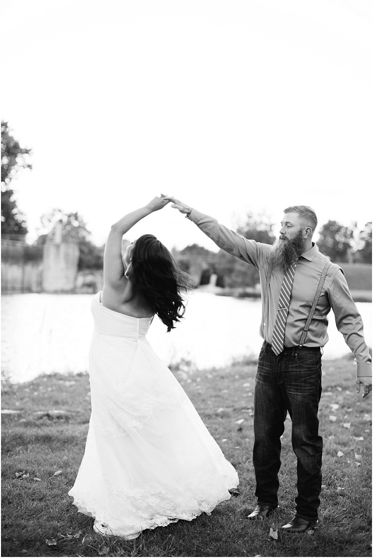 grom-twirling-bride-at-little-chute-waterfront-wedding-by-green-bay-wedding-photographer-kyra-rane-photography