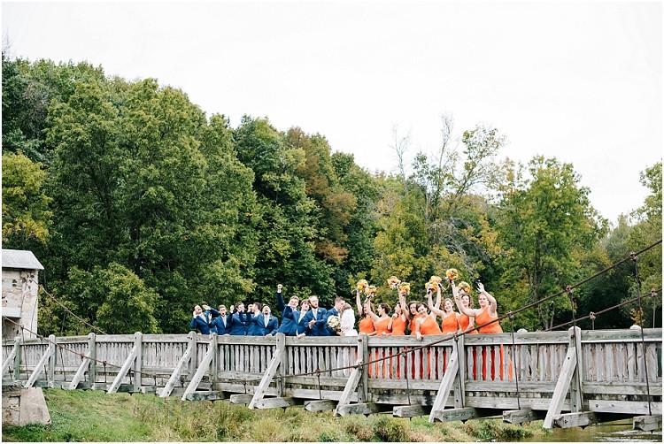 wedding-party-on-bridge-at-pamperin-park-wedding-by-appleton-wedding-photographer-kyra-rane-photography