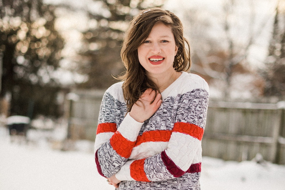 smiling-in-red-sweater-at-my-word-for-2020-by-appleton-wedding-photographer-kyra-rane-photography
