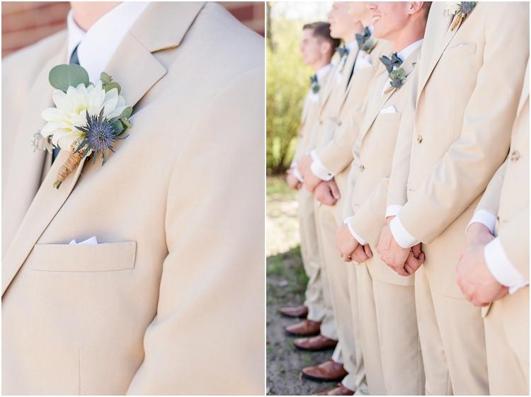 groomsmen-standing-side-by-side-at-minnesota-wedding-by-green-bay-wedding-photographer-kyra-rane-photography