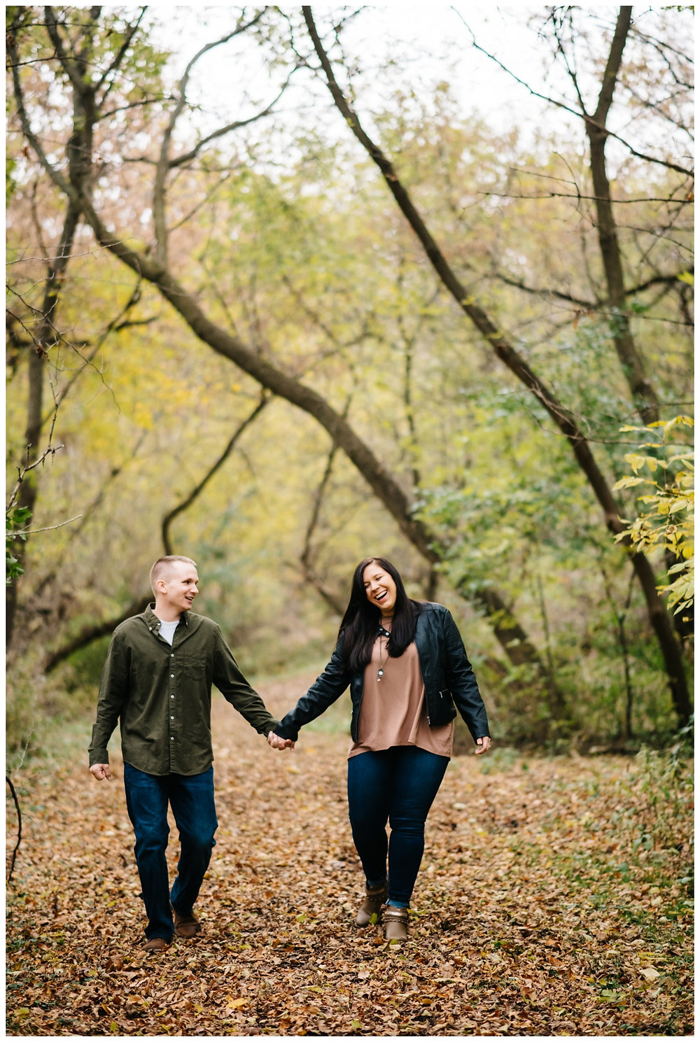 engaged-couple-laughing-and-walking-at-green-bay-engagement-session-by-appleton-wedding-photographer-kyra-rane-photography