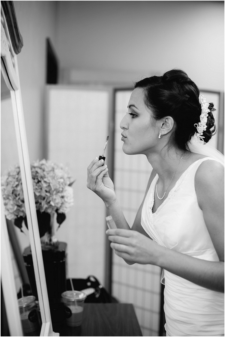 bride-putting-on-lip-gloss-at-de-pere-wedding-by-green-bay-wedding-photographer-kyra-rane-photography
