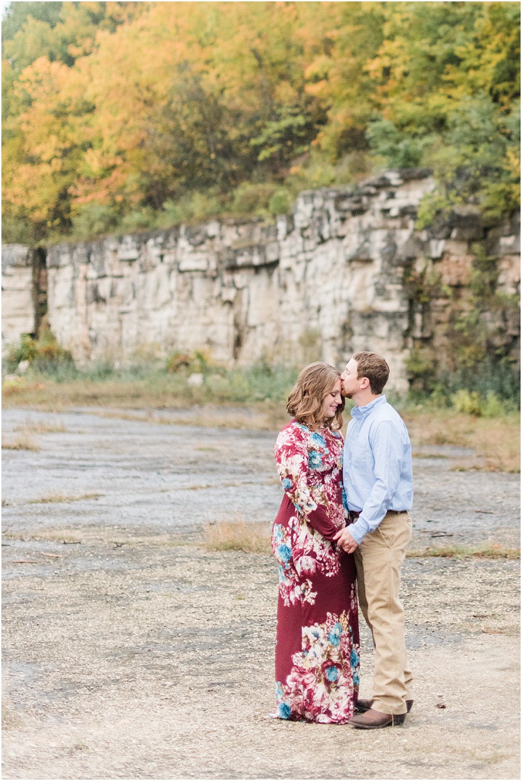 engaged-couple-kiss-forehead-at-high-cliff-engagement-session-by-appleton-wedding-photographer-kyra-rane-photography