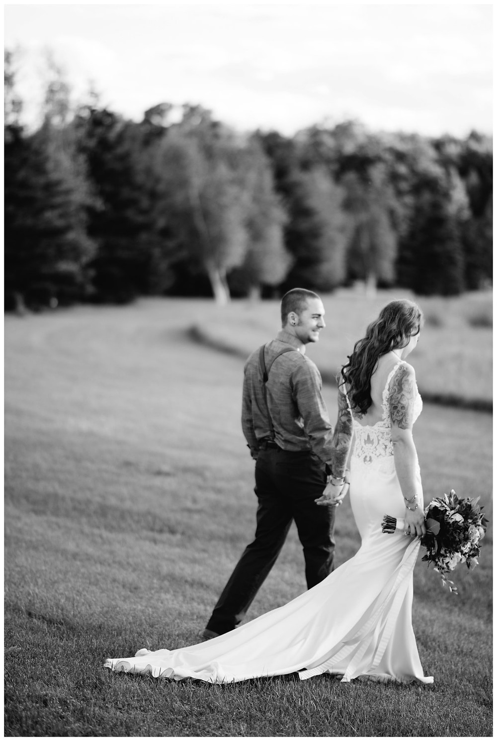 wedding-couple-walking-away-holding-hands-at-homestead-meadows-styled-shoot-by-milwaukee-wedding-photographer-kyra-rane-photography