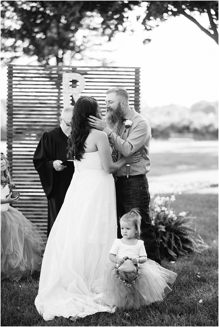 bride-and-groom-first-kiss-at-little-chute-waterfront-wedding-by-appleton-wedding-photographer-kyra-rane-photography