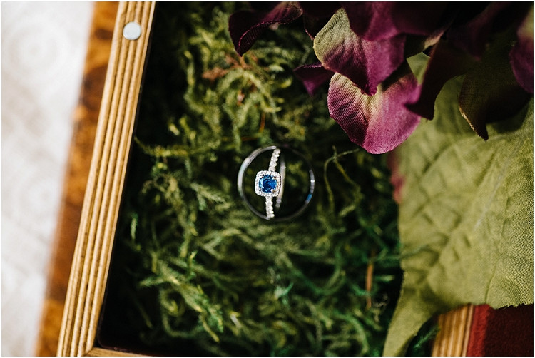 saphire-engagement-ring-and-black-wedding-band-at-barnsite-retreat-and-events-wedding-by-appleton-wedding-photographer-kyra-rane-photography